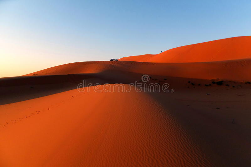 The Red Sands with Car on Dunes in the Kingdom of Saudi Arabia royalty free stock image