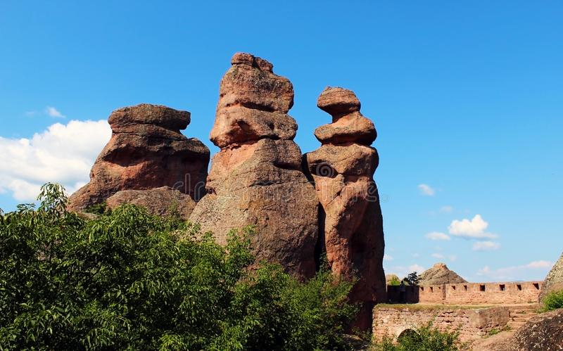 Red sandstone rock pillars against clear blue sky. In Belogradchik royalty free stock photo