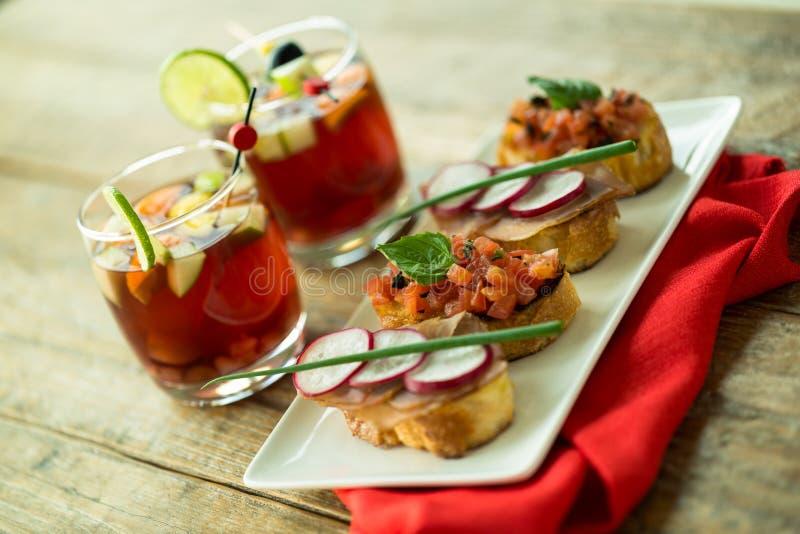 Red sangria and bruschetta stock photo