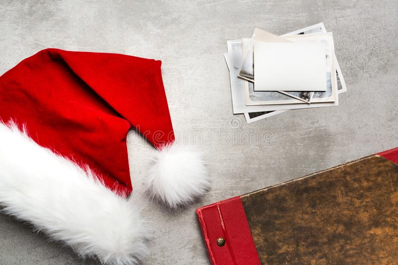 Red santa hat and old photos royalty free stock photography