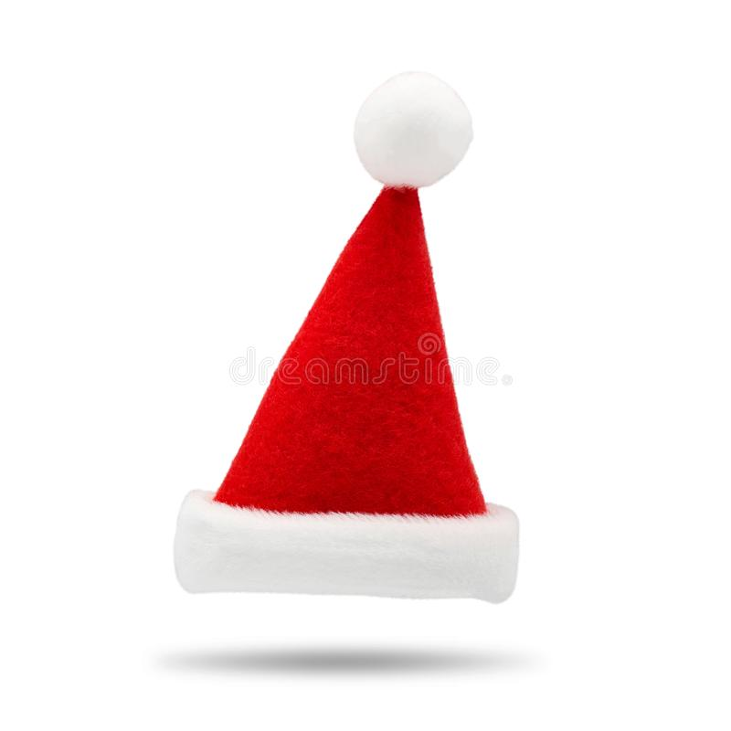 Red santa hat on white background. Fashion Santa Claus accessory for your design. Christmas cap for wear on head. Red santa hat on white background. Fashion stock photos