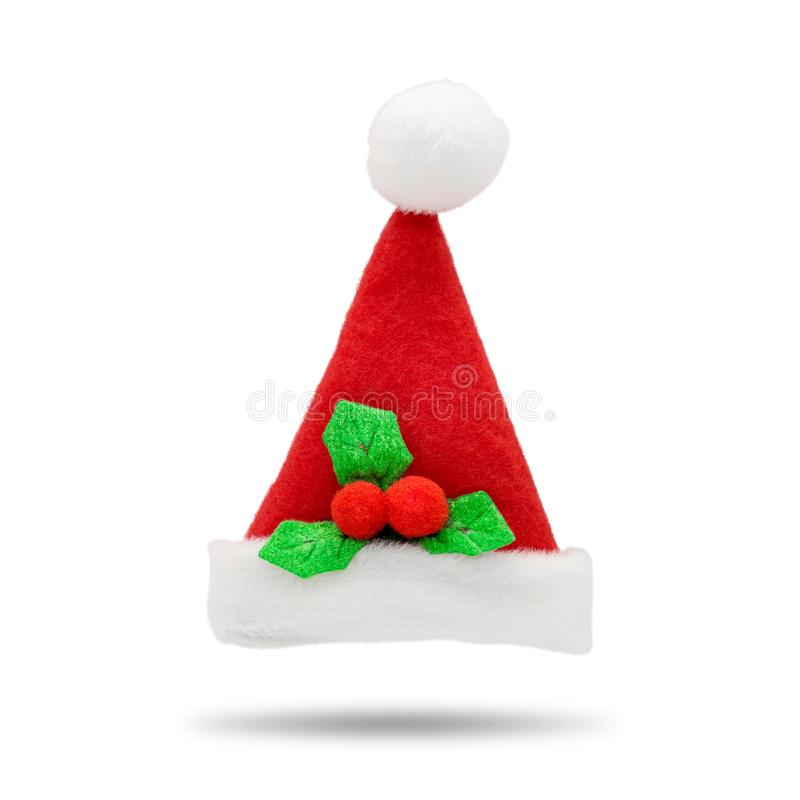 Red santa hat on white background. Fashion Santa Claus accessory for your design. Christmas cap for wear on head stock photos