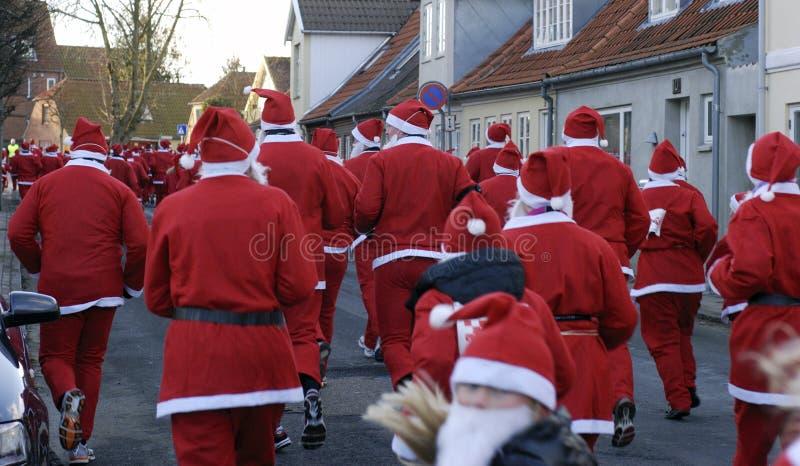 Red Santa Running royalty free stock images