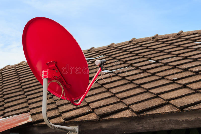 Download Red Satellite TV Receiver Dish On The Old Tiles Roof Stock Photo - Image of copy, outdoor: 34201260