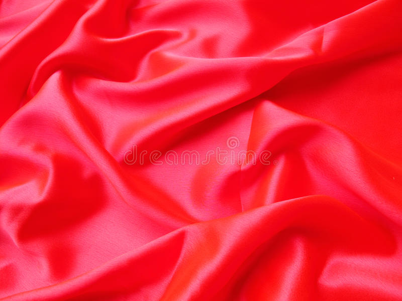Red Satin. A silky and lustrous red satin background royalty free stock image