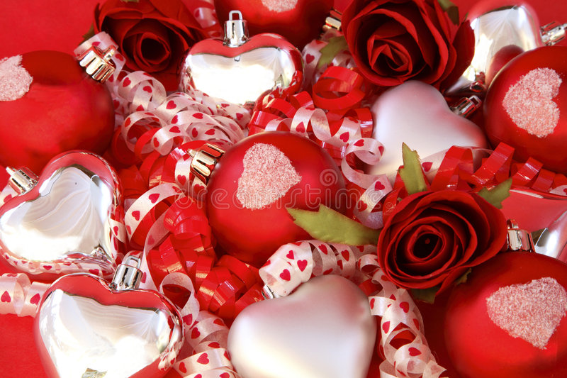 Red satin balls, silver hearts with roses and ribb stock images
