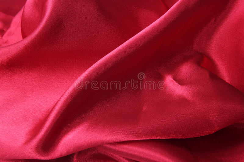 Red Satin Cloth. With waves creating a romantic texture royalty free stock images