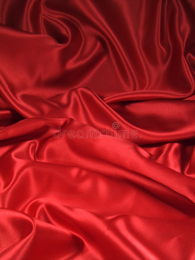 Red Satin Fabric [Portrait]. A luxurious red satin folded fabric, useful for backgrounds stock photography