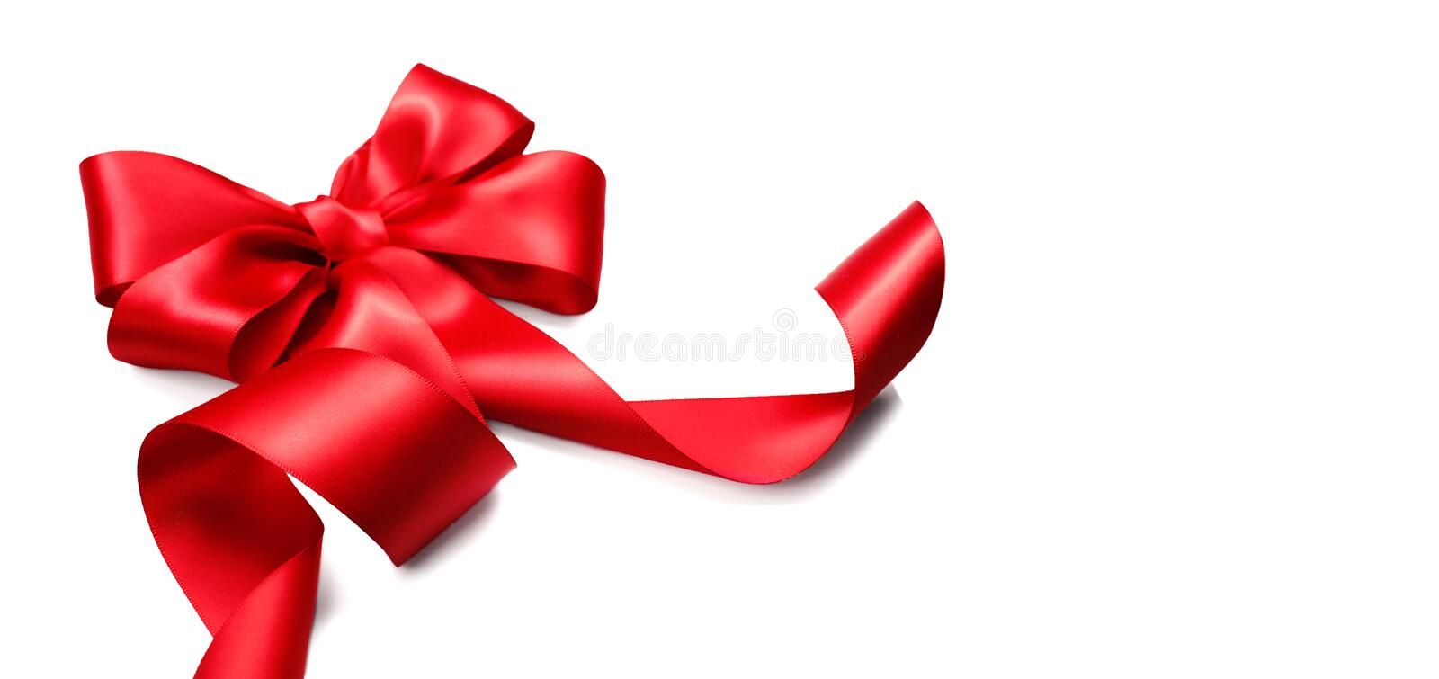 Red satin gift bow. Ribbon isolated on white royalty free stock photos