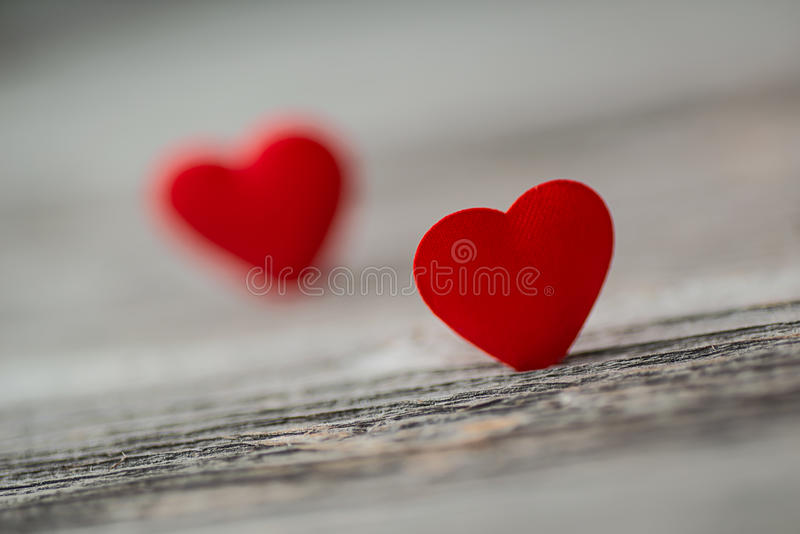 Red satin heart on wood background, valentines or mothers day stock photography