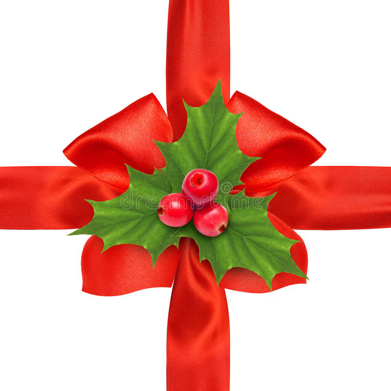 Red satin ribbon bow and holly berry sprig