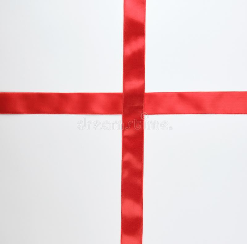 red satin ribbon cross to cross on white background stock images