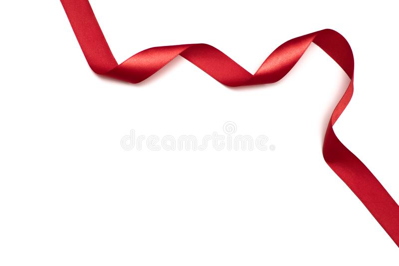 Red satin ribbon isolated on white backgroun.  royalty free stock images