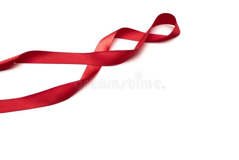 Red satin ribbon isolated on white backgroun.  royalty free stock photos