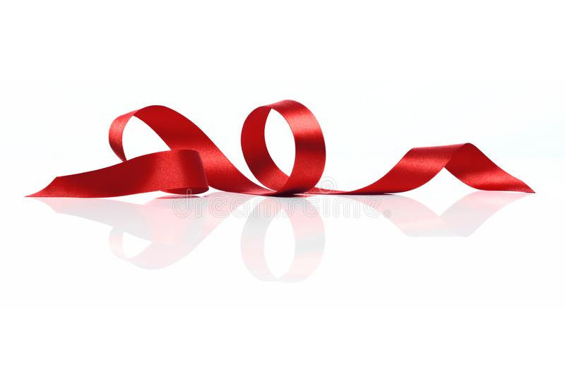 Red Satin Ribbon Twirl royaltyfri foto