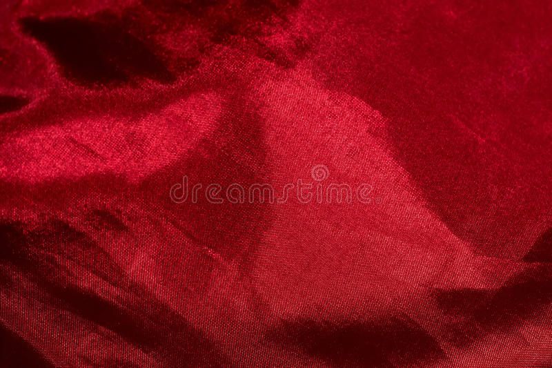 Red Satin. Red silk fabric macro as background, shallow focus royalty free stock images