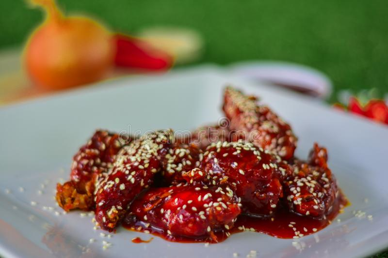 Red sauce chicken wings food royalty free stock photography