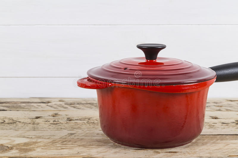 Red saucepan. Bright red saucepan with its lid royalty free stock images