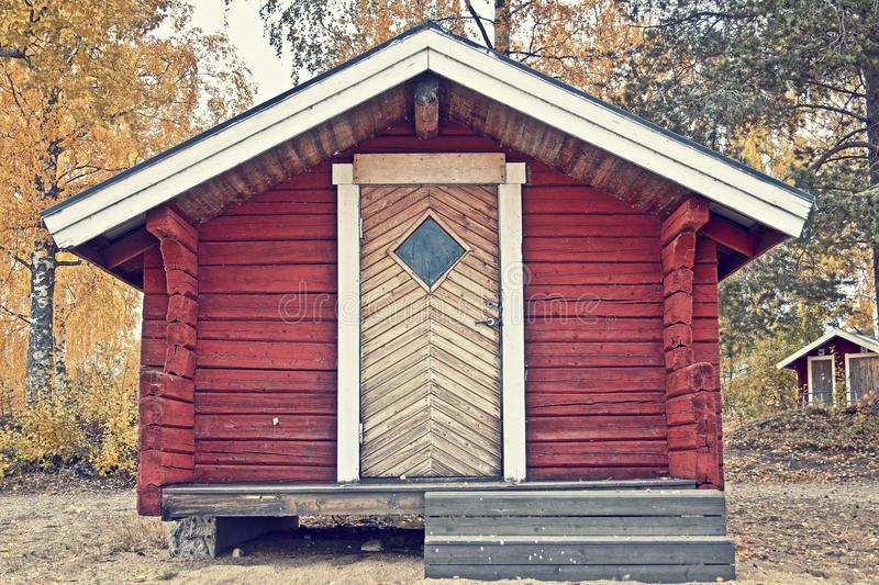Red scandinavian cottage during spring. Very nice colors and details. royalty free stock photo