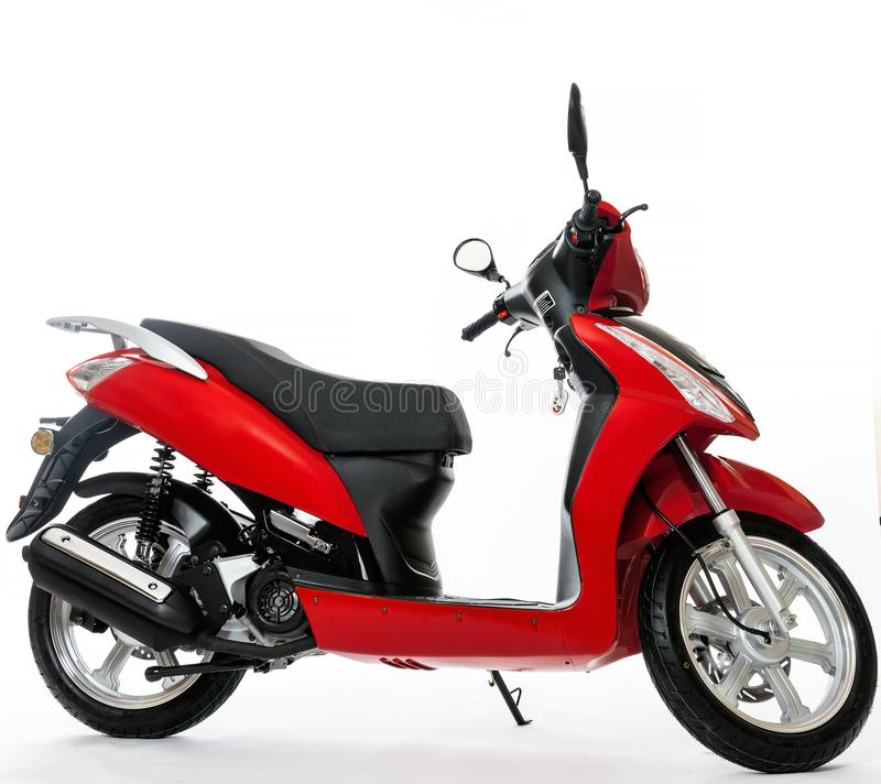 Red scooter stands on a white background royalty free stock photo
