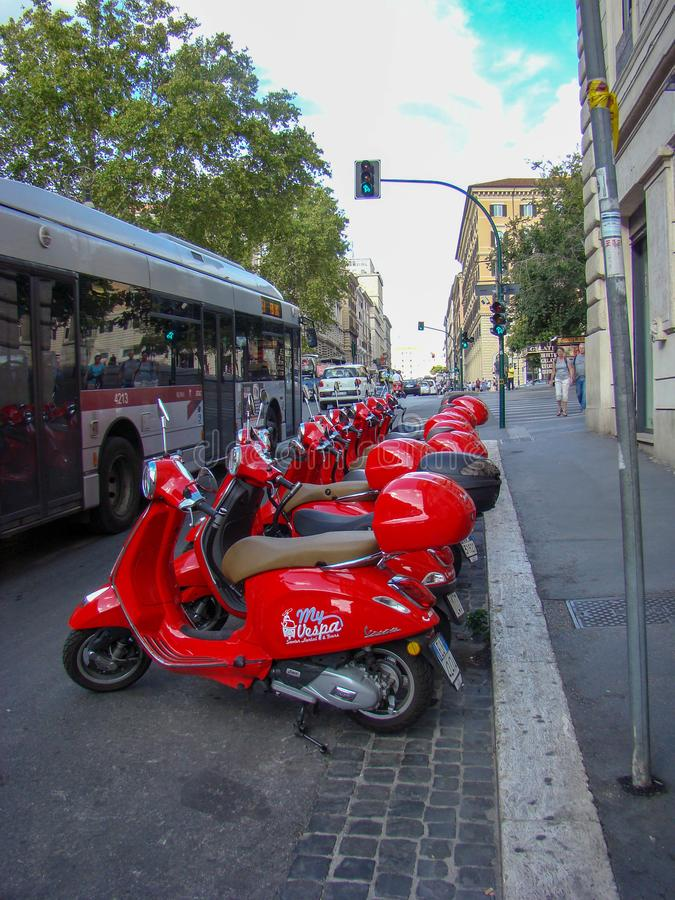Red scooters in Rome stock photography