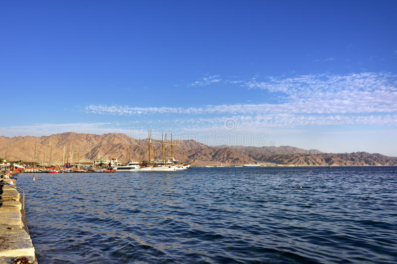 Red sea near Eilat. At sunset time, famous international resort - the southest city of Israel stock photography