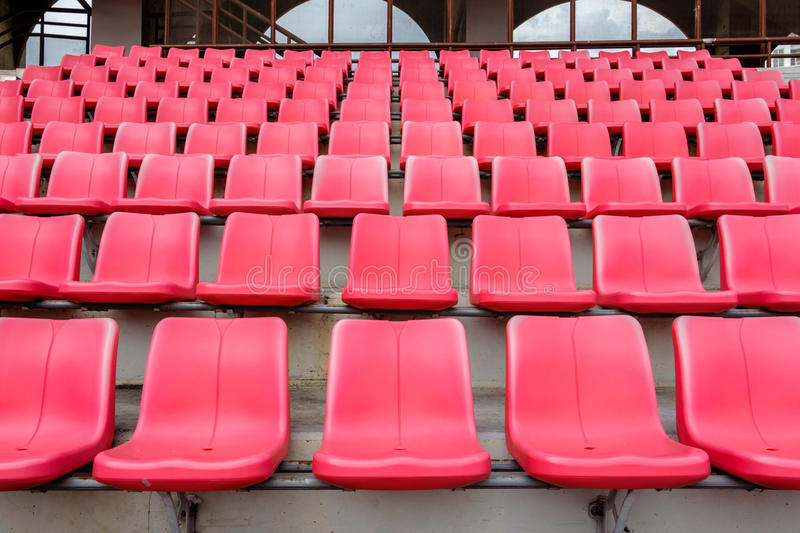 Red seats in football stadium. Empty red seats in football stadium royalty free stock photos
