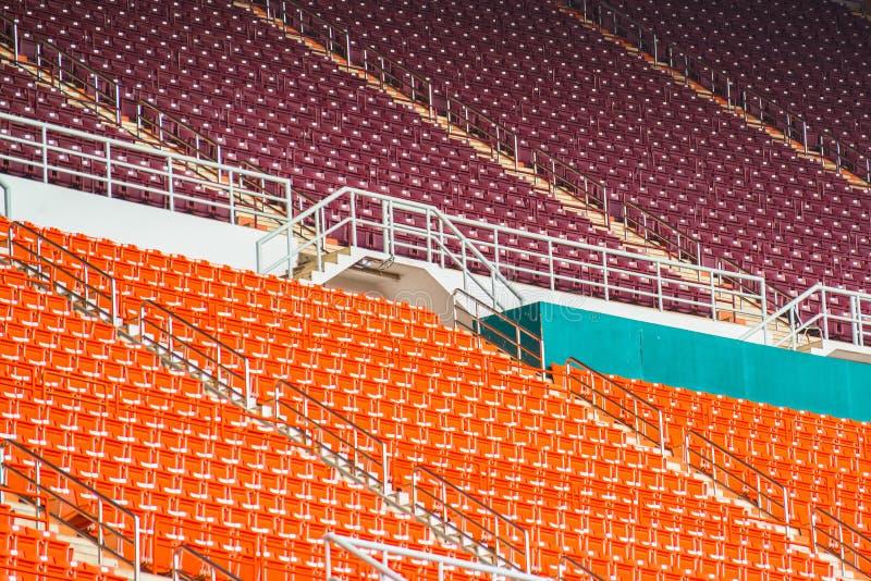 Red seats on stadium steps bleacher royalty free stock photos