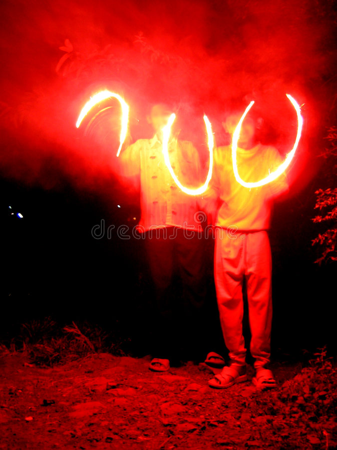 Red Semi-Circlez. Children make red semicircles with sparklers in Diwali festival of India royalty free stock photography