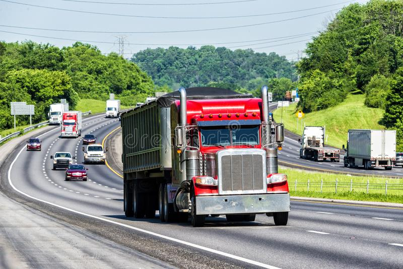 Red Semi Climbs Hill on Interstate royalty free stock photo