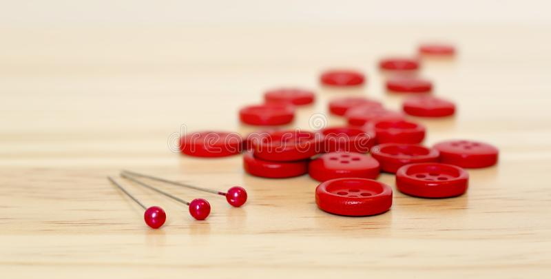 Red sewing supplies, buttons and pins, web banner. Red sewing supplies - web banner of buttons and pins, DIY concept royalty free stock image