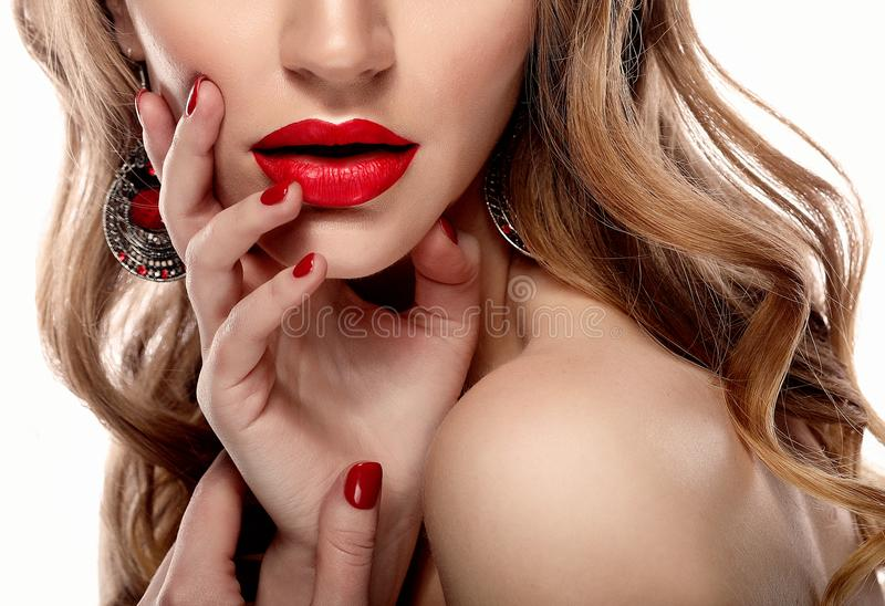 Red Lips and Nails closeup. Blond hair. Manicure and Makeup. Make up concept. Close up stock photo