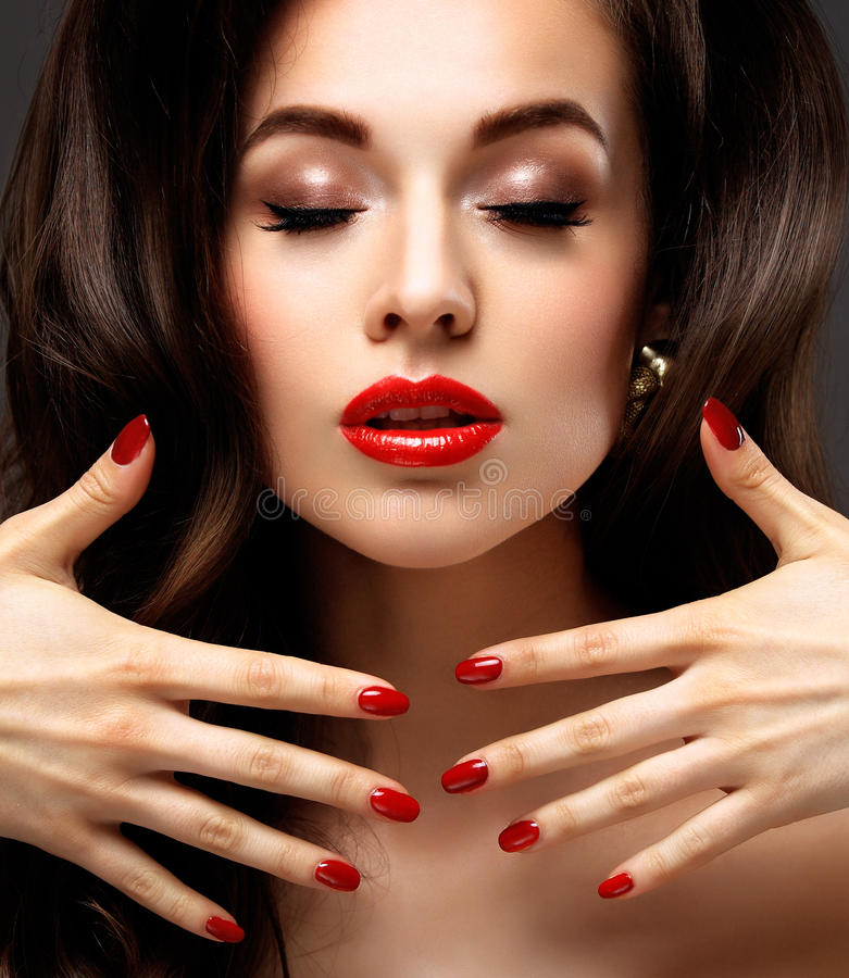 Red Lips and Nails closeup. Manicure and Makeup. Make up concept. Half of Beauty model girl's face on. Red Lips and Nails closeup. Open Mouth. Manicure and royalty free stock photography