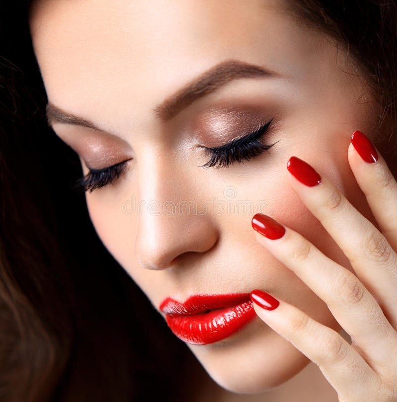 Red Lips and Nails closeup. Open Mouth. Manicure and Makeup. Make up concept. Half of Beauty model girl's face isolated on black stock images