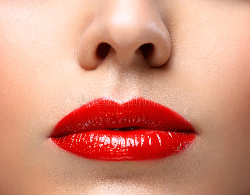 Red Lips and Nails closeup. Open Mouth. Manicure and Makeup. Make up concept. Half of Beauty model girl's face isolated on black royalty free stock photos