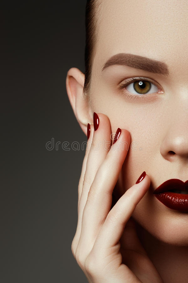 Red lips and nails closeup. Open mouth. Manicure and makeup. Make up concept. Kiss royalty free stock photography