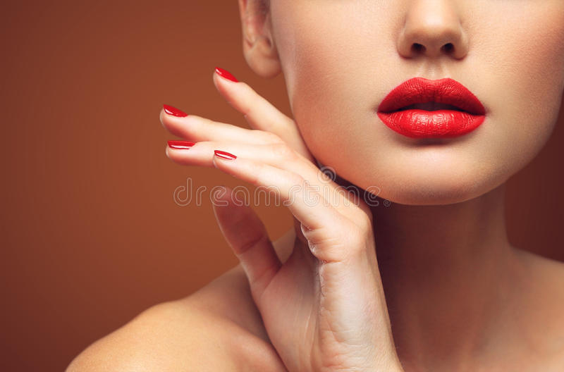 Red Lips and Nails closeup. Open Mouth. Manicure and Makeup. Make up concept. Kiss stock image