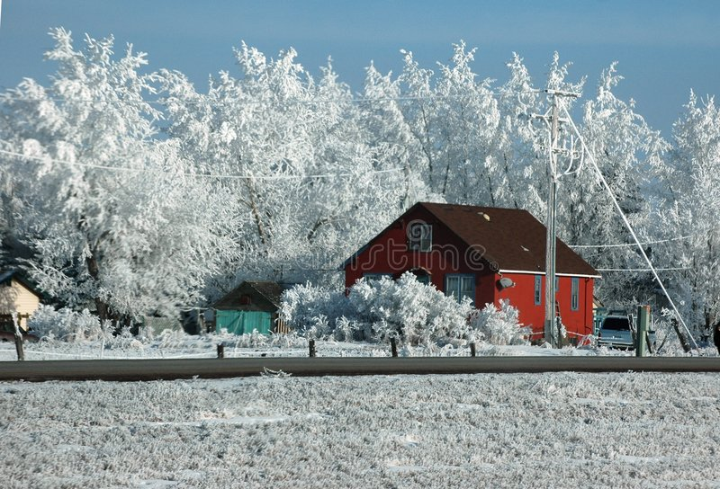 Red Shack on Highway in Winter. Red shack on rural highway after several days of ice-fog, Saskatchewan, Canada royalty free stock photography