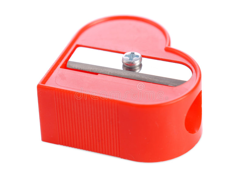 Red sharpener. Red plastic heart-shaped pencil sharpener over white background royalty free stock photo