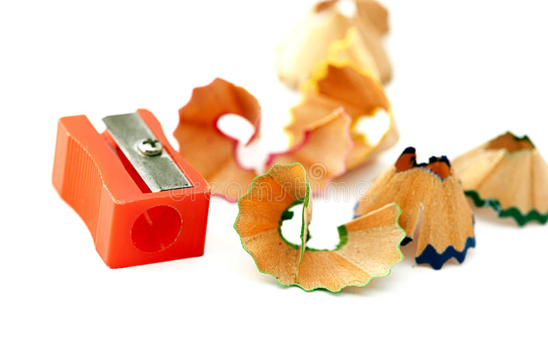 Red sharpener and pencils shaving stock photos