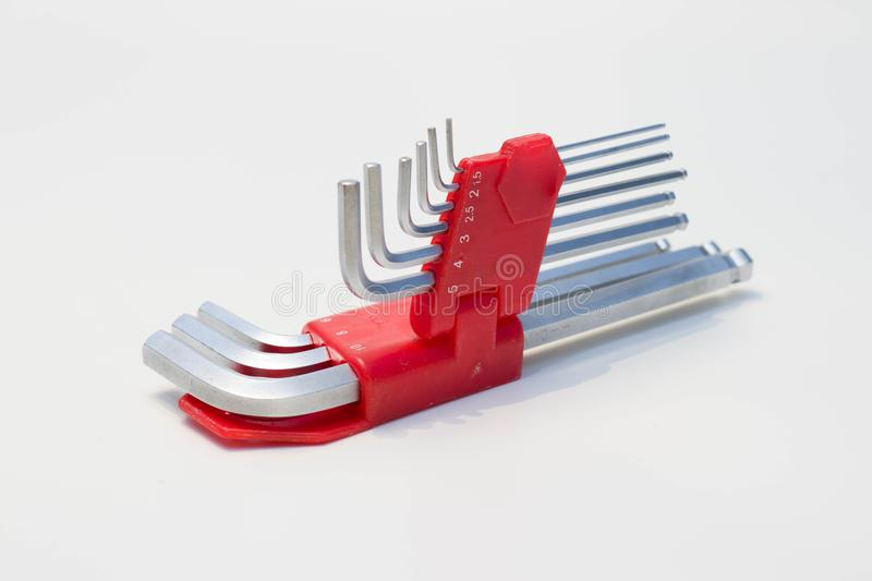 Red shiny allen tool set for bolts and screws. On whit background royalty free stock photo