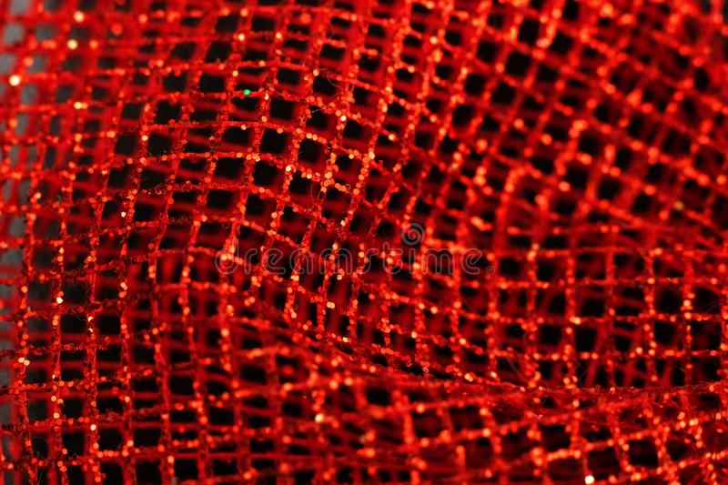 Red shiny mesh gift wrapping close up royalty free stock photos