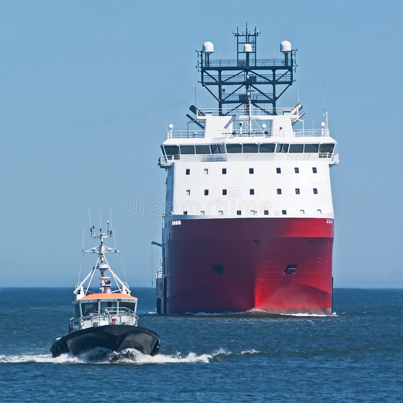 Red Ship With Pilot Boat Royalty Free Stock Images