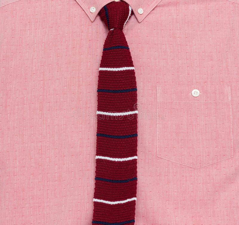 Men`s stylish red shirt and knit tie royalty free stock photography
