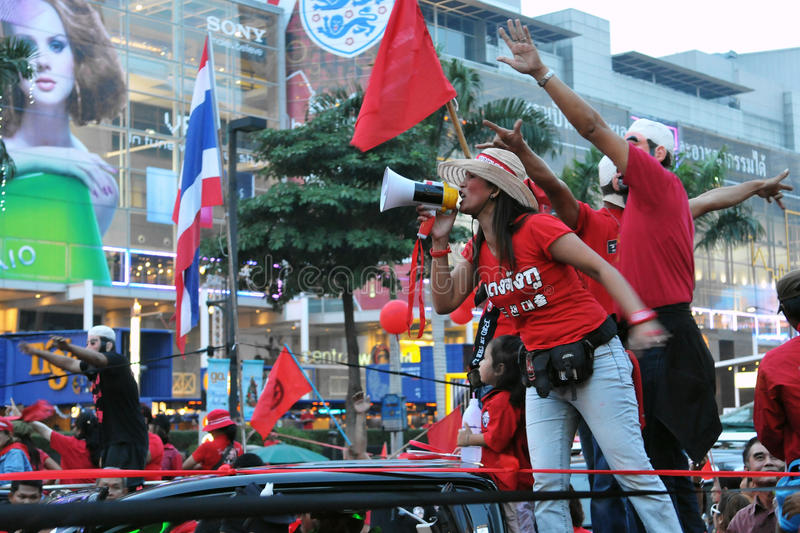 Red Shirts Protest in Central Bangkok. BANGKOK - DECEMBER 19: A Red Shirt leader uses a loud hailer to direct protesters during a 10,000 strong anti government stock images