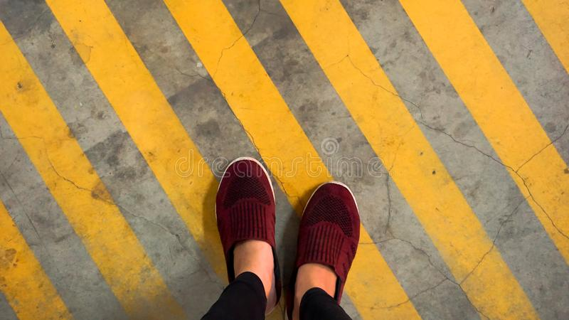 A red shoe on yellow strip line stock images