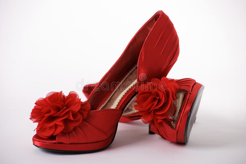 Red shoes and carnation royalty free stock photos