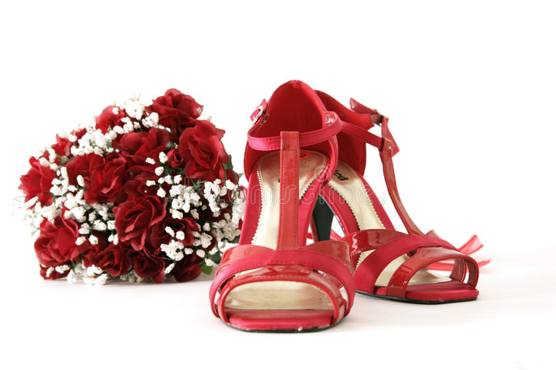 Red shoes and flowers royalty free stock images