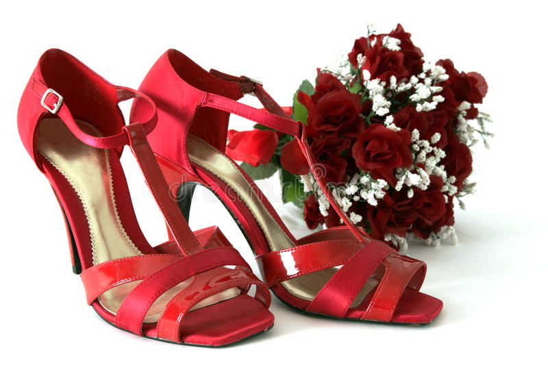 Red shoes and flowers royalty free stock photos