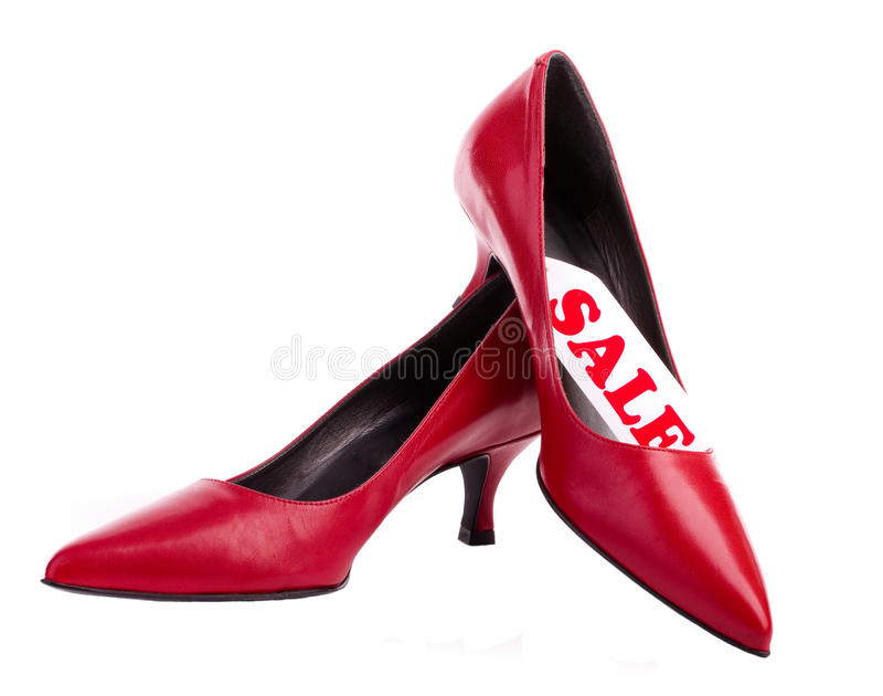 Red shoes with label sale. Isolated on white royalty free stock image